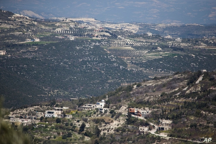 FILE -- A view towards the Turkish border from Kinsibba, Syria.