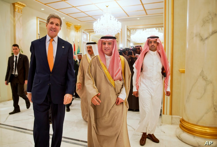 U.S. Secretary of State John Kerry walks with Saudi Foreign Minister Adel al-Jubeir, center, to attend a ?Gulf Cooperation Council meeting at King Salman Regional Air Base in Riyadh, Saudi Arabia, Jan. 23, 2016.