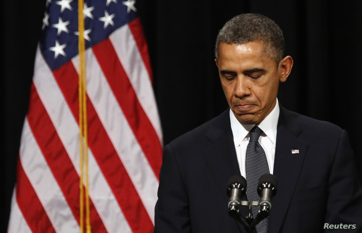 U.S. President Barack Obama speaks at a vigil held at Newtown High School for families of victims of the Sandy Hook Elementary School shooting in Newtown, Connecticut December 16, 2012. Obama is visiting Newtown High School to meet with the families ...