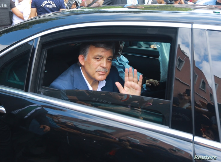 Former Turkish President Abdullah Gul waves as he leaves a memorial service for the victims of the thwarted coup in Istanbul, July 17, 2016.