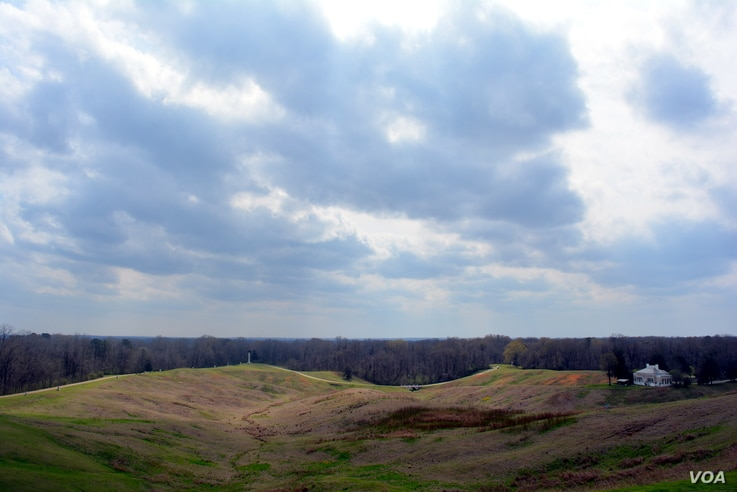 """This photograph taken at Vicksburg National Military Park shows the """"no man's land"""" area between Confederate and Union Lines. The white column in the far distance is one of many state monuments that honor the fallen soldiers from that state."""