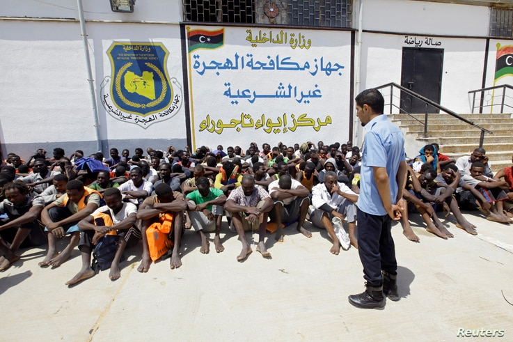 Migrants sit at the Tajoura branch of the Anti-Illegal Immigration Authority, in Tajoura, Libya, Aug. 6, 2017.