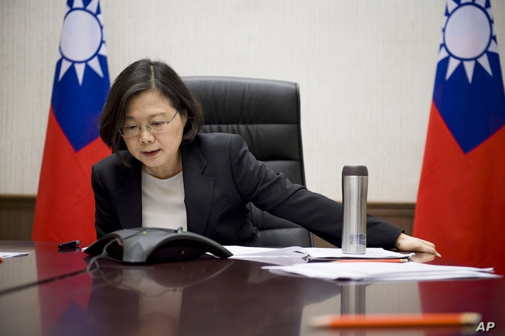 Taiwan's President Tsai Ing-wen speaks with U.S. President-elect Donald Trump through a speaker phone in Taipei, Taiwan. (Taiwan Presidential Office via AP)