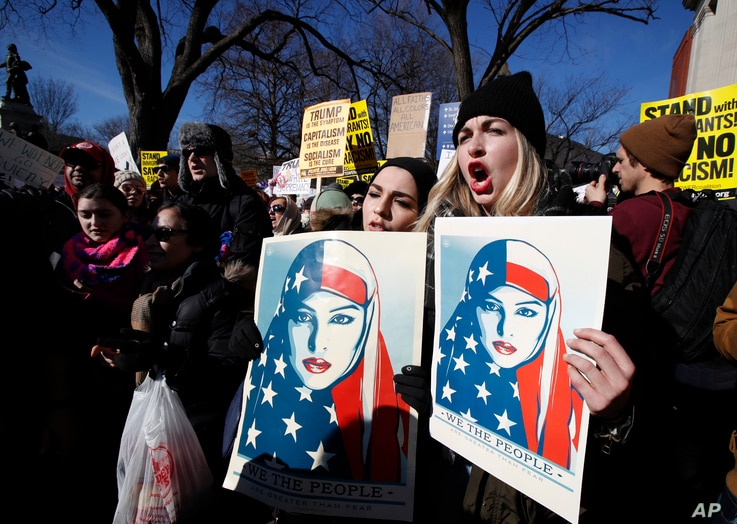 Demonstrators chants during a rally protesting the immigration policies of President Donald Trump, near the White House in Washington, Feb. 4, 2017.
