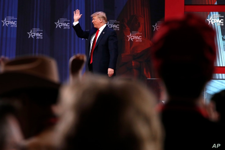 President Donald Trump waves after speaking to the Conservative Political Action Conference (CPAC), at National Harbor, Md., Feb. 23, 2018.
