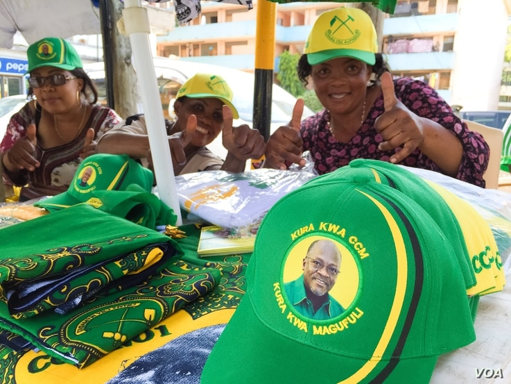 Vendors in Dar es Salaam near the CCM headquarters building promote their party's candidate, John Magufuli on Oct. 22, 2015. (Photo: Jill Craig / VOA)