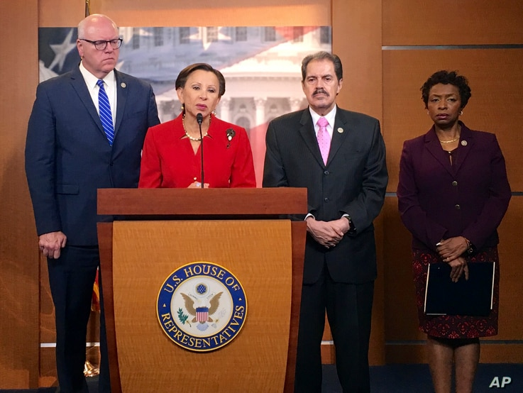From left, New York Reps. Joe Crowley, Nydia Velazquez, Jose Serrano and Yvette Clarke talk about the damage in Puerto Rico caused by Hurricane Maria, on Capitol Hill in Washington, Sept. 26, 2017.