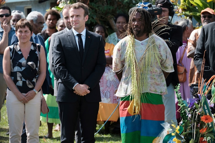 French President Emmanuel Macron pays tribute to the Kanak tribe of Hwadrilla, where the 19 Kanak militants are buried, on Ouvea Island, off New Caledonia, May 5, 2018, during ceremonies marking the 30th anniversary of when Kanak tribesmen took Frenc...