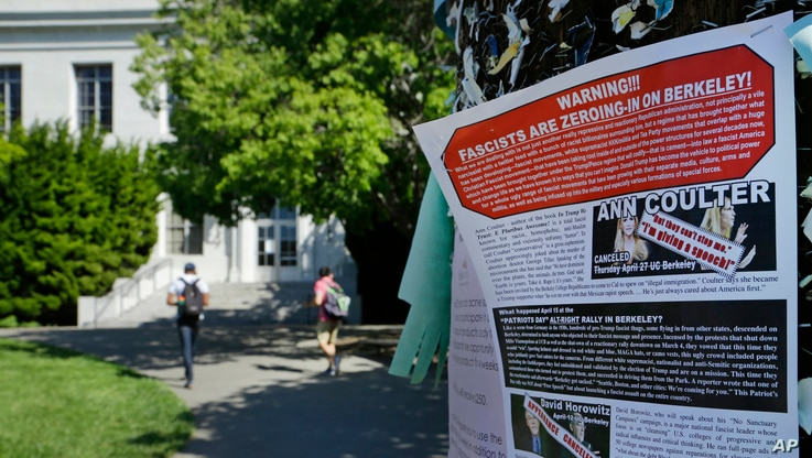 FILE - A leaflet is seen stapled to a message board near Sproul Hall on the University of California, Berkeley in Berkeley, Calif. Students who invited Ann Coulter to speak on campus filed a lawsuit, April 24, 2017, against the university, saying it ...