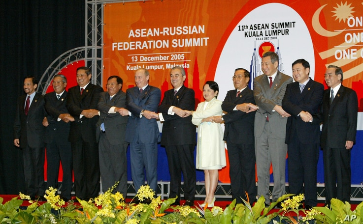 FILE - Russiaan President Vladimir Putin (5-L) is seen with leaders of ASEAN member countries during one of Russia's earlier overtures to the group, at its summit in Kuala Lumpur, Malaysia, Dec. 13, 2005.
