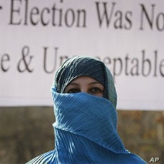 A former legislator marches during a post-election protest in Kabul, 07 Nov 2010