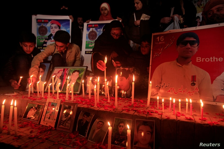 People light candles to remember the victims of an attack on the Army Public School in 2014. The candlelight vigil was held in Peshawar, Pakistan, Dec. 15, 2016.