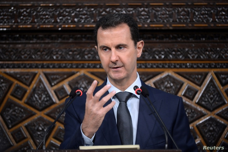 Syrian President Bashar al-Assad speaks to Parliament members in Damascus in this photo handed out by SANA, the Syrian Arab News Agency, June 7, 2016.