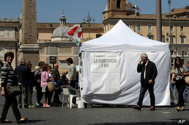 Citizens line up at a makeshift gazebo set up around the country for the Democratic party's primary elections, in Rome, Italy, April 30, 2017.