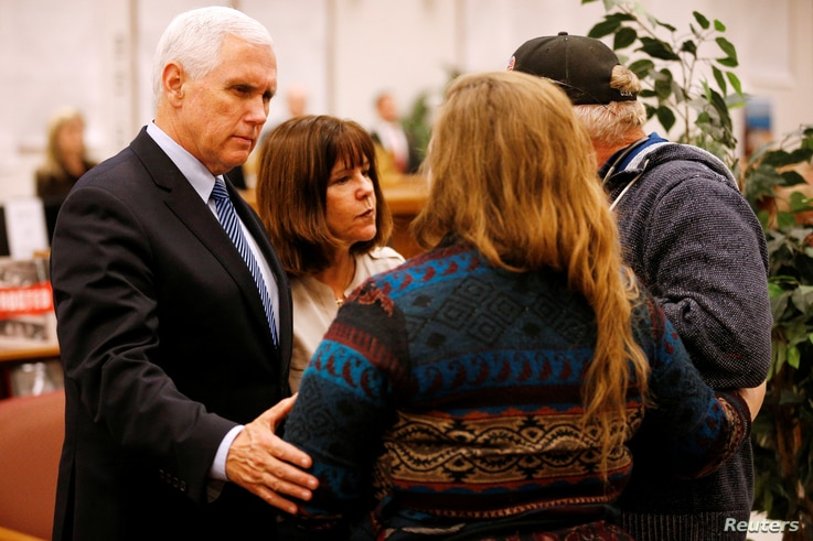 U.S. Vice President Mike Pence and his wife, Karen, greet a couple at Floresville High School during a visit with family and victims of the shooting at First Baptist Church in Sutherland Springs, before a vigil in Floresville, Texas, Nov. 8, 2017.