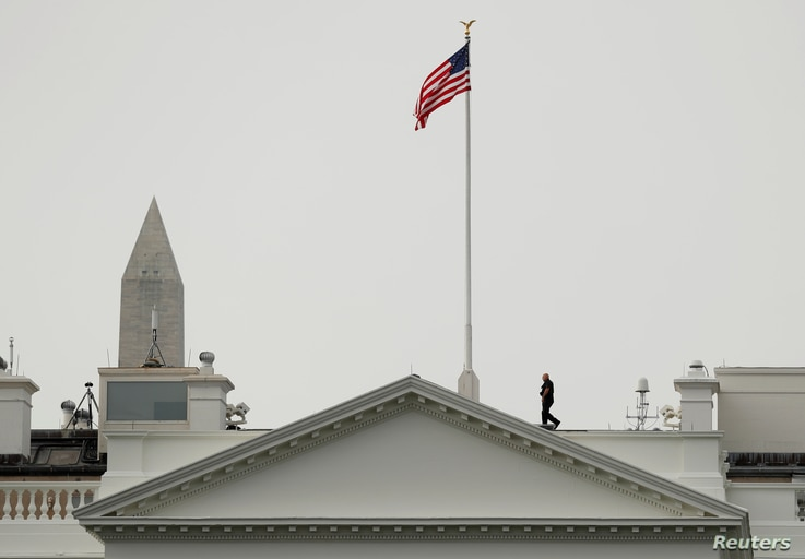 The U.S. flag flies at full staff less than 48 hours after John McCain's death over the White House in Washington, U.S., August 27, 2018.