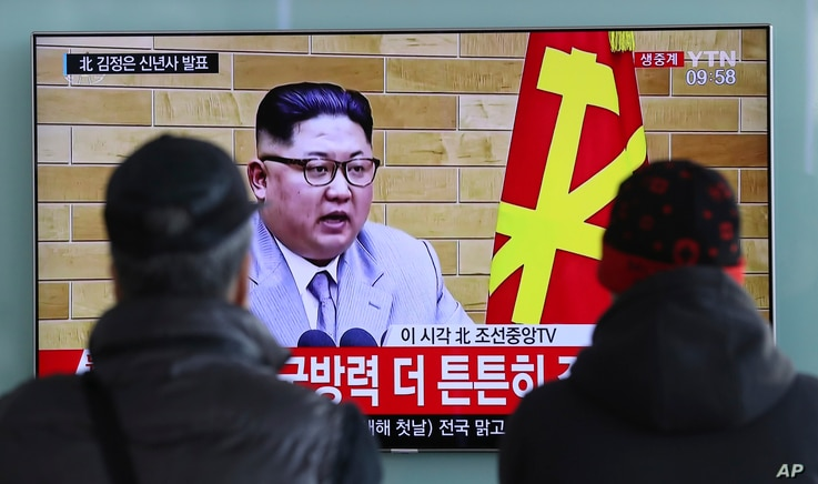 South Koreans watch a TV news program showing North Korean leader Kim Jong Un's New Year's speech, at the Seoul Railway Station in Seoul, South Korea, Jan. 1, 2018.
