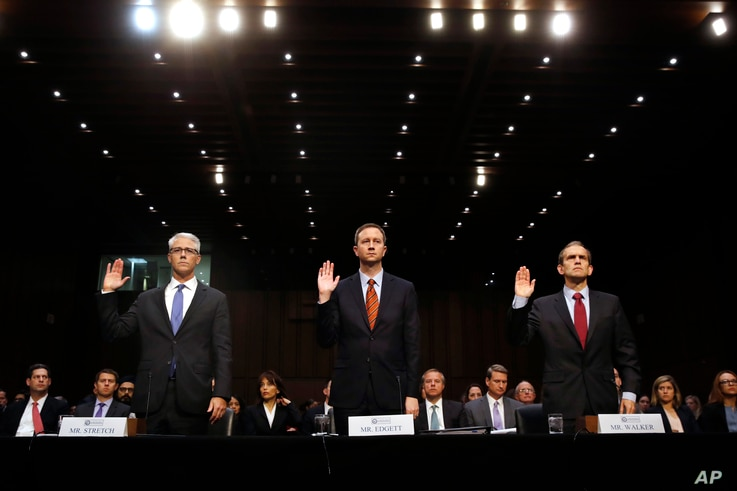 From left, Facebook's General Counsel Colin Stretch, Twitter's Acting General Counsel Sean Edgett, and Google's Senior Vice President and General Counsel Kent Walker, are sworn in for a Senate Intelligence Committee hearing on Russian election activi...