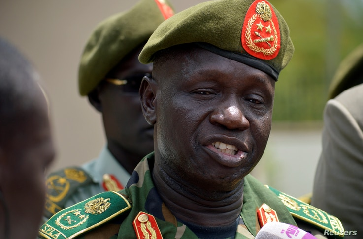 South Sudan's new army chief, General James Ajongo, speaks to reporters after his swearing-in at the Presidential Palace in Juba, South Sudan, May 10, 2017.