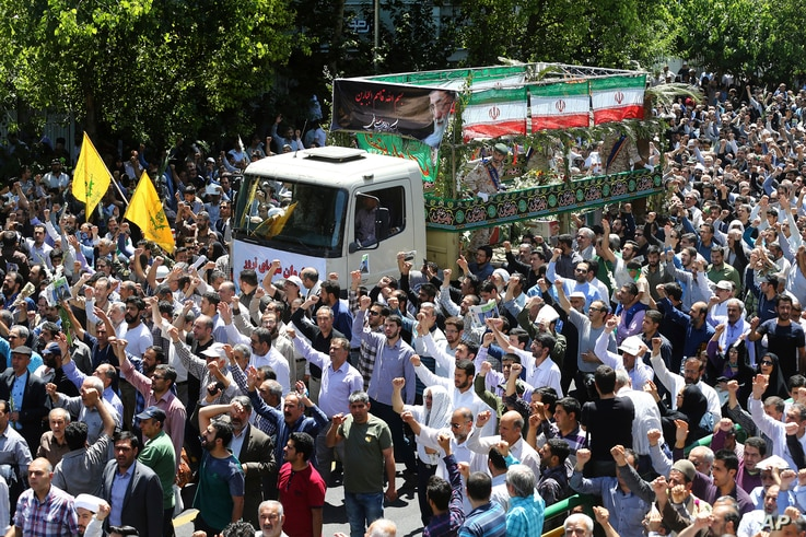 Iranians in Tehran attend the funeral of victims of an Islamic State militant attack, June 9, 2017. Iranian leaders accused the United States and Saudi Arabia of supporting the Islamic State-claimed dual attacks that killed 17 people in Tehran this w...
