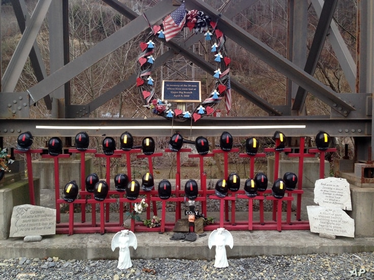 FILE - A memorial to 29 miners killed in an April 2010 explosion is shown Dec. 3, 2015, at the entrance to the Upper Big Branch mine in Montcoal, West Virginia. Don Blankenship, former CEO of Massey Energy, was convicted of conspiring to willfully vi...