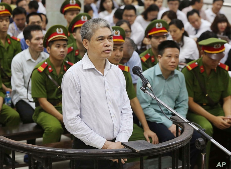 Nguyen Xuan Son, former general director of OceanBank, appears in a court in Hanoi, Vietnam, Monday, Aug. 28, 2017.  Son and 50 bankers and business executives were put on trial Monday for alleged graft and mismanagement causing $69 million in losses...