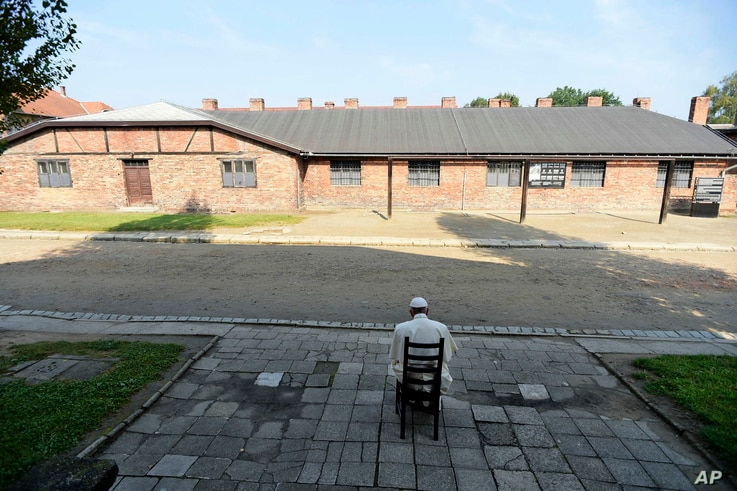 Pope Francis prays during his visit to the former Nazi German death camp of Auschwitz-Birkenau in Oswiecim, Poland, July 29, 2016.