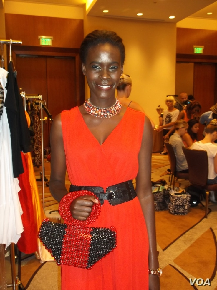 Model poses with a handbag made from recycled paper and beads by Cameroon businesswoman Jacqueline Kamsu. (Kamsu)