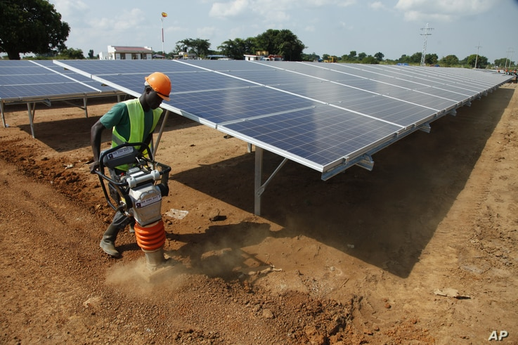 A Ugandan worker builds a solar plant in Soroti about 300 kilometers east of Uganda capital Kampala. In this electricity-starved rural part of Uganda, men ride bicycles several kilometers to the nearest market town simply to charge their phones.