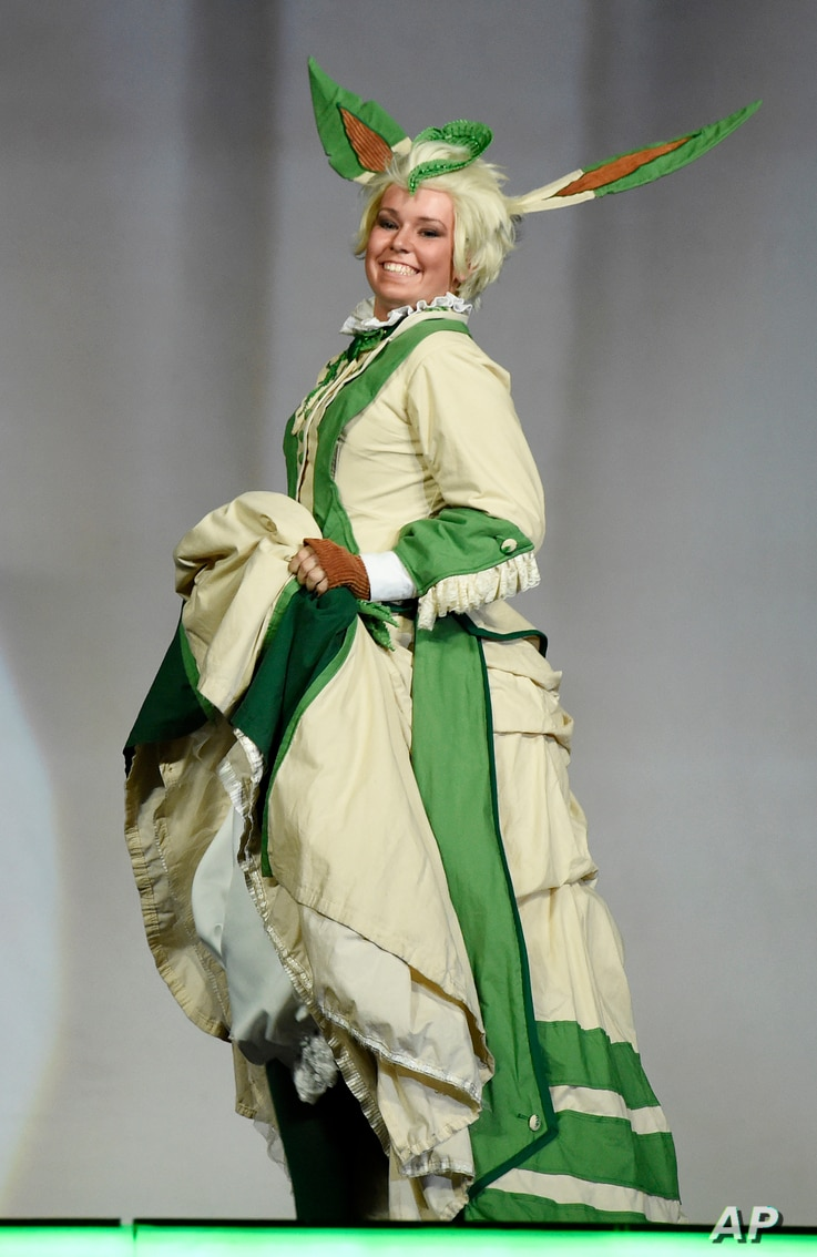 """Dorothy Thicket, performing as """"Victorian Leafeon,"""" poses for the audience during the 41st Annual Comic-Con Masquerade costume competition in San Diego, California, July 11, 2015."""