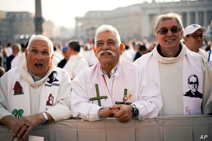 Priests wearing vestments with the effigy of martyred Salvadoran Archbishop Oscar Romero attend a canonization ceremony in St. Peter's Square at the Vatican, Oct. 14, 2018.