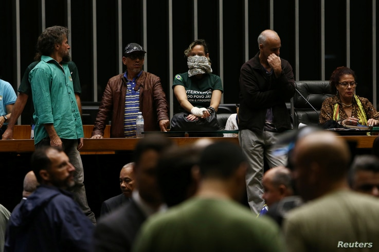 Demonstrators in favor of a military intervention in Brazil invade the lower house plenary session in Brasilia, Brazil, Nov. 16, 2016.
