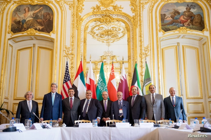 U.S. Secretary of State John Kerry (2nd L) poses for members of the media with foreign ministers of the Gulf Cooperation Council as they meet to discuss Middle East concerns about an emerging nuclear deal with Iran, at the Chief of Mission Residence ...