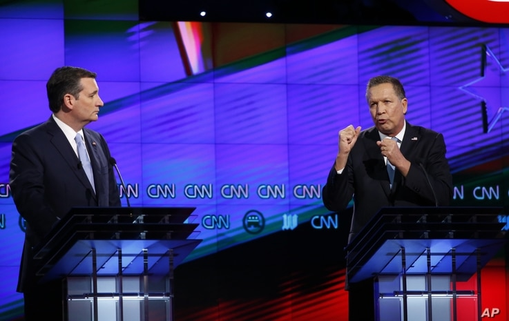 Republican presidential candidate, Ohio Gov. John Kasich, right,  speaks as Republican presidential candidate, Sen. Ted Cruz, R-Texas, listens, during the Republican presidential debate sponsored by CNN, Salem Media Group and the Washington Times at ...