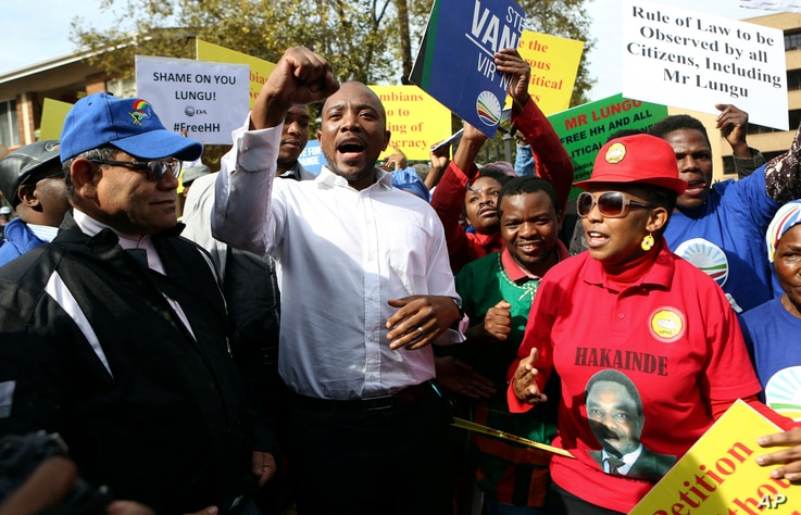 South Africa's opposition Democratic Alliance party leader, Mmusi Maimane, center, protests with fellow supporters of Zambia's jailed opposition leader Hakainde Hichilema outside the High Commission of Zambia in Pretoria, South Africa, May 26, 2017. ...