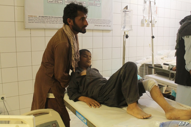 An Afghan boy is treated at a hospital following an airstrike in Kunduz province, northern Afghanistan, April 2, 2018.