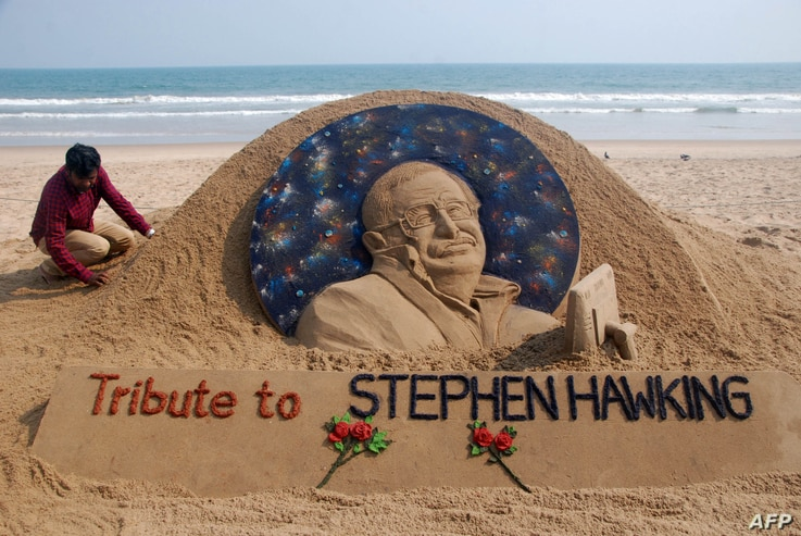 Sand artist Sudarsan Patnaik gives final touches to a sculpture in honour of British physicist and award-winning author Stephen Hawking at Puri beach, some 65 kms. from Bhubaneswar on March 14, 2018.