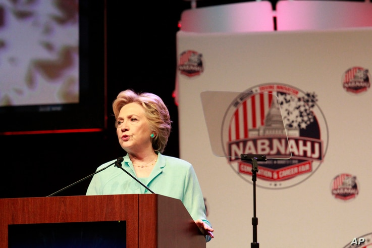 Democratic presidential nominee Hillary Clinton addresses the 2016 National Association of Black Journalists (NABJ) and National Association of Hispanic Journalists (NAHJ) joint convention, Aug. 5, 2016, in Washington.