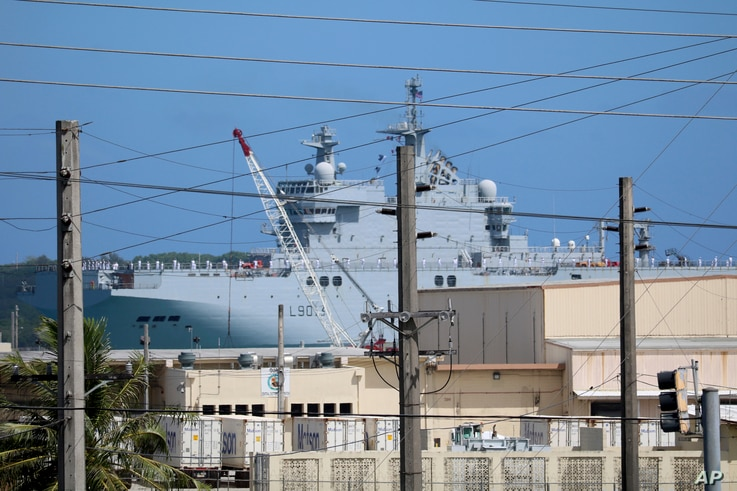 FS Mistral, a French amphibious assault ship, pulls into port at Naval Base Guam, May 11, 2017, near Hagatna, Guam. Troops from the United States, Japan,France and the United Kingdomare gathering for drills they say will show support for the free p
