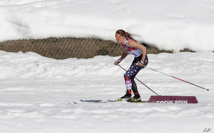 United States' Sophie Caldwell skis with a sleeveless top as temperatures went well over the freezing point during the women's 10K classical-style cross-country race at the 2014 Winter Olympics, Feb. 13, 2014.