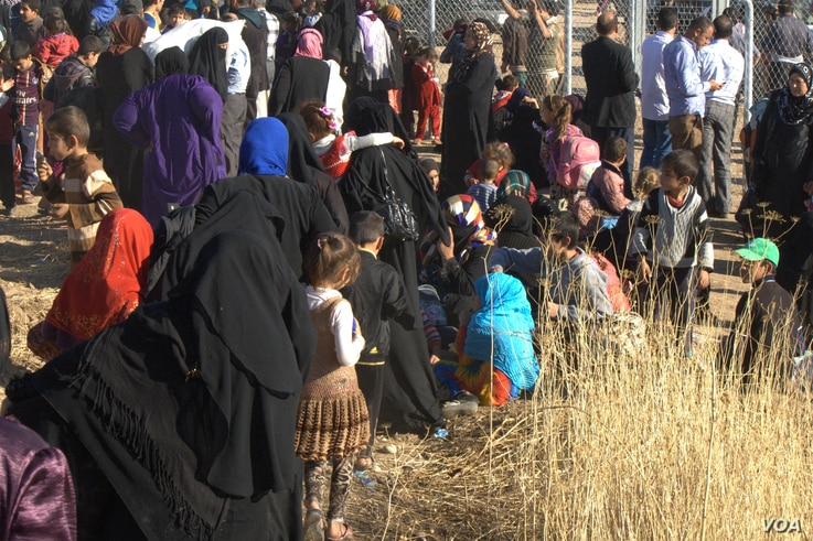 Outside Khazir camp, thousands of people wait in line to register in Iraqi Kurdistan, Nov. 5, 2016. The International Organization for Migration says more than 45,000 people have been displaced since the Mosul offensive began more than three weeks ag...