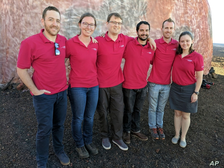 Scientists Joshua Ehrlich, from left, Laura Lark, Sam Payler, Brian Ramos, Jay Bevington and Ansley Barnard, pose for a photo before they enter a geodesic dome called Hawaii Space Exploration Analog and Simulation, or HI-SEAS located 8,200 feet above...