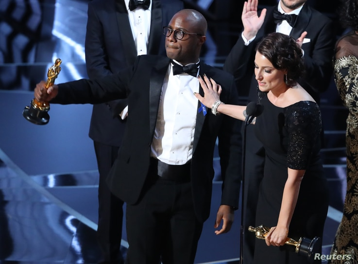 """Director Barry Jenkins and producer Adele Romanski celebrating the best picture win for """"Moonlight."""""""