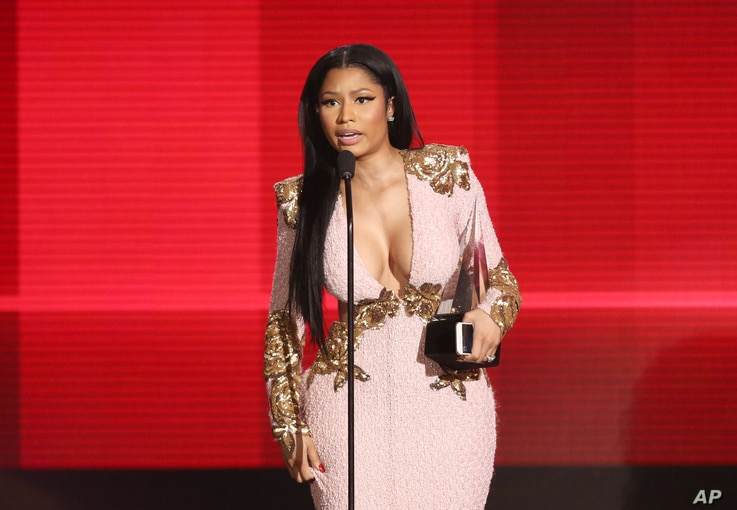 """Nicki Minaj accepts the award for favorite album - rap/hip-hop for """"The Pinkprint"""" at the American Music Awards at the Microsoft Theater on Nov. 22, 2015, in Los Angeles."""