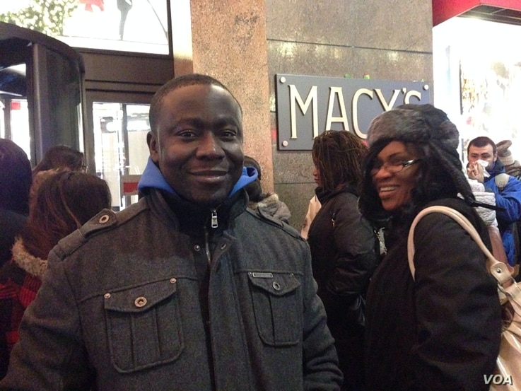 Emanuel Gomez, a shopper from Ghana has a game plan that includes photos of the items he aims to buy on his smartphone, outside Macy's Herald Square in New York on Thanksgiving, Nov. 28, 2013. (Photo Sandra Lemaire)