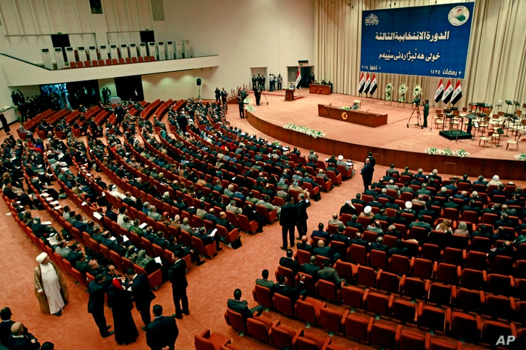 Iraqi newly elected parliament members attend the first session of parliament in the heavily fortified Green Zone in Baghdad, July 1, 2014.