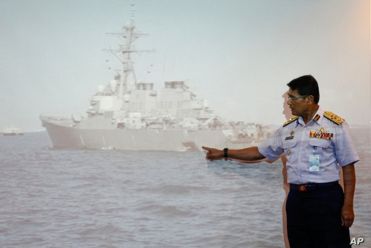 Malaysian Maritime Director Indera Abu Bakar points the damage of USS John S. McCain shown on a screen during a press conference in Putrajaya, Malaysia, Aug. 21, 2017.