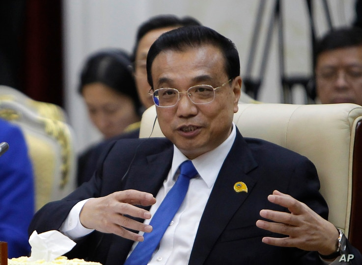 China's Premier Li Keqiang gestures during the opening of the Lancang-Mekong Cooperation forum Leaders Meeting in Phnom Penh, Cambodia, Jan. 10, 2018.
