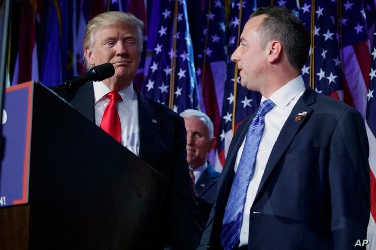 FILE - President-elect Donald Trump (L) stands with Republican National Committee Chairman Reince Priebus during an election night rally in New York, Nov. 9, 2016, as Vice president-elect Mike Pence (background) looks on. Trump named Priebus his Whit...