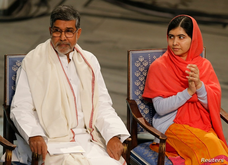 Nobel Peace Prize laureates Kailash Satyarthi and Malala Yousafzai listen to speeches during the Nobel Peace Prize awards ceremony at the City Hall in Oslo, Dec. 10, 2014.